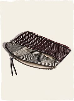 The Fair Trade envelope clutch, handwoven in intersecting stripes of black, cream and burgundy cotton. Sales support the advancement of rural Mayan women.