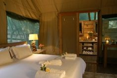 Slightly upstream from the wellness centre, the well appointed safari-style Lodge Tents are positioned beneath a canopy of  tambotie and jackalberry trees. The exclusive tents offer bathrooms, air-conditioning, high thread count percale cotton sheets and bedside i-pods.