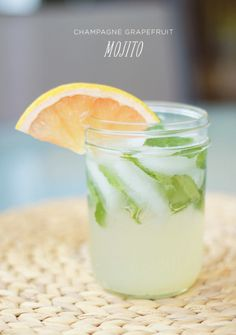 Champagne grapefruit mojito: 1 ounce freshly squeezed lime juice 1 ounce freshly squeezed pink grapefruit juice 1 tablespoon superfine sugar 6 to 8 fresh mint leaves 2 ounces light rum 3 to 4 ounces chilled champagne (or club soda) Quartered grapefruit slice for garnish