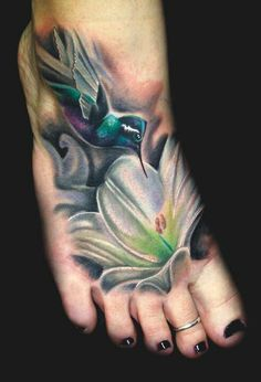 Gorgeous hummingbird and flower tattoo