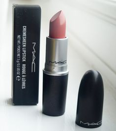 MAC Fanfare. Neutral pink but shows up quite bright coral on me. Perfect with a summer tan for me.