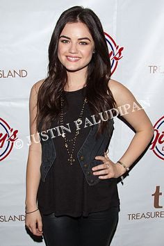Lucy Hale hosts a fan meet and greet luncheon with a live performance at Gilley's Saloon, Dance Hall & Bar-B-Que at the Treasure Island Hotel and Casino on December 10, 2013 in Las Vegas, Nevada.