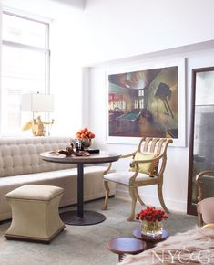 A photography by Birney Imes accents the sitting area in a contemporary Manhattan apartment. #NYC&G