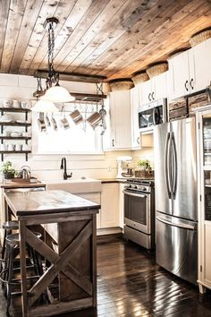 small farmhouse style kitchen with rustic touches and statement ceiling