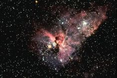 The central portion of the Eta Carinae Nebula, NGC 3372, also known as the Keyhole Nebula, in the constellation of Carina. This gaseous bright nebula surrounds the peculiar variable star Eta Carinae, with overlying clouds of dark material. The nebula is 9000 light-years from Earth. Cerro Tololo 4-meter Blanco telescope, 1976: north is at the top.