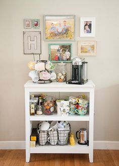Load up an old bookshelf with all of your coffee + tea accessories to save space on counter tops.