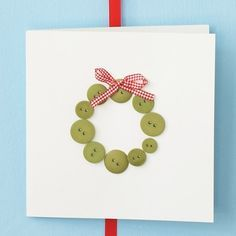 Cute homemade Christmas card design using buttons and ribbon. #diy
