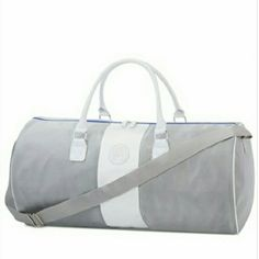 """$PRICE DROP$ Vince Camuto Duffle Bag Was $29. PRICE REDUCED TODAY. NO OFFERS. PRICE IS FIRM.  Gray and white bag has silver tone metallic hardware and top zip closure. Material: polyester-like, with faux leather trim. Approximate dimensions: 21""""l x 35"""" h x 11""""w with 52"""" crossbody strap. Gift with purchase. Vince Camuto Bags Travel Bags"""