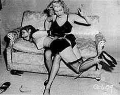 Bettie Page is tied and spanked in an image from Bizarre