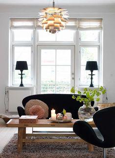 Swan sofa+Swan chair by Arne Jacobsen; Artichoke pendant lamp by Poul Henningsen.