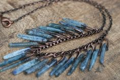Rustic Kyanite Crystal Primitive Necklace - Rustic Primitive . Winter . raw crystals . statement necklace . choker long crystals . artisan by Tribalis on Etsy https://www.etsy.com/listing/253344559/rustic-kyanite-crystal-primitive
