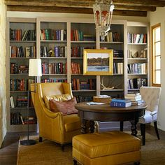 My perfect idea of a cozy library. Big comfy chair, large table for all the browsing of books, close lighting...the only thing I would like change in this situation is color of room/shelves AND I'd add a ton more books!!