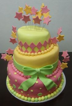 pink, yellow and green cake with bows and stars