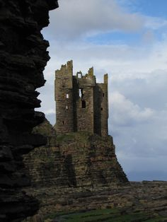 Keiss Castle, Scotland - 1595 - take care if you visit it is in  dangerous condition today.  This photograph was taken at low tide.