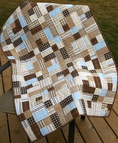 Boy quilt made of men's dress shirts. I like the mixture of blocks on this. 2-fabric squares and 4-patches.