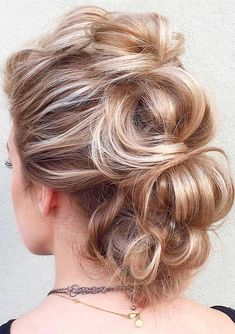 Top trendy fauxhawk braided updo hairstyles for ladies to sport in 2017 2018.