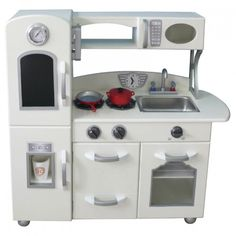 Here's a complete kitchen setup for your budding chef! This wooden play kitchen includes a stove, sink, storage cabinets, and a state of the art refrigerator that includes an upper fridge and a lower freezer. There's even a microwave for those times when the little chef is in a big hurry.All paints used are non-toxic. Some assembly required.