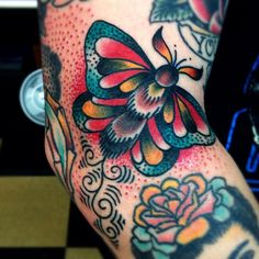 KC Lange // butterfly tattoo, love the red dots