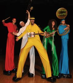 Top Bananas colourful stilt band. Top Bananas play Funk, Disco and Ska while on stilts. Available in a variety of costumes from Jungle and Jack Frost to Sporty and Black Tie. Big Foot Events.