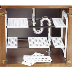 Shelving for under your sink is modular; you can move the shelving segments to fit around your pipes however they are configured.  Genius.  One problem:  the product isn't sold in the US (UK only). There's a similar one at bed, bath and beyond