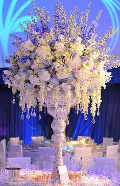 White, blue, and lavender tall centerpiece with dangling crystals.