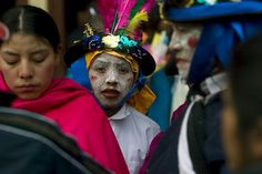Boy in traditional costume in the Fiestas of Inti Raymi in northern Ecuador