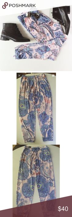 """Express harem jogger pants paisley pink NWT S This is a pair of harem pants by Express. They are a light pink with gorgeous multi print paisley pattern. Two front pockets, two back pockets. Backs are still sewn shut. Elastic waist. Size S. NWT. Retail for $59.90. 95% polyester, 5% spandex. Machine wash, dry flat.  Waist: 14""""-19"""" Hips: 20""""-26"""" Inseam: 29"""" Ankle: 4.5""""-7"""" Rise: 11.5"""" Express Pants Track Pants & Joggers"""