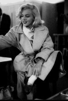 Marilyn. Camel coat sitting. Photo by Milton Greene, 1953.