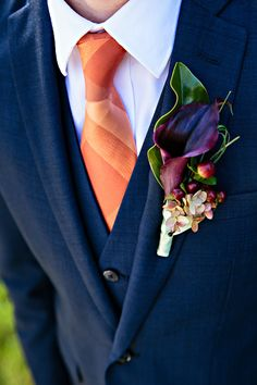 Orange Tie and Purple Cala Lily Boutonniere