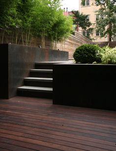 steel planters, uplighted. fence.