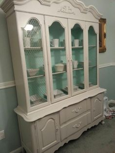 China cupboard inspiration- love the accent color on the inside
