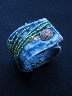 Inspiration.... would NOT pay $40 bucks!!!!Up-cycled Denim cuff. $39.95, via Etsy. Possible Napkin Rings?