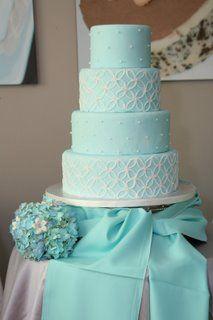 Tiffany Blue Themed Wedding Cake.  Love the swath of fabric at the bottom.  Very striking!