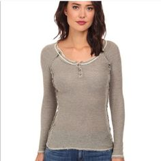 Free people rag tag sweater Fine-spun cotton shapes a raglan-sleeve henley pullover styled for a snug fit. Reverse seams and light tatter at the edges enhance the rugged, feminine look.   100% cotton. Free People Sweaters