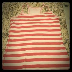Red and white striped razor back tank top Very cute ribbed red and white razor back tank top. Built in bra also. Very comfortable and perfect for summer! XL but fits like a large Tops Tank Tops