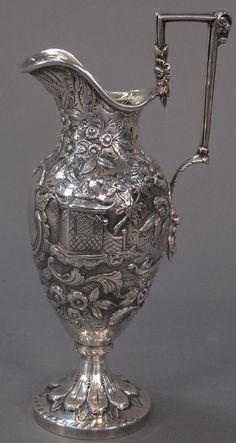 Nadeau's Auctions - Kirk Ewer with pagoda repousse body and flowers, handle with rams head, hallmarked SK. ht. 12 1/4in.; 26.2 t oz. - Realized Price: $2,400.00