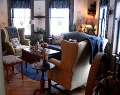 Apple Hill; living room; prim country; angled sofa with table behind - love the lamp in that corner