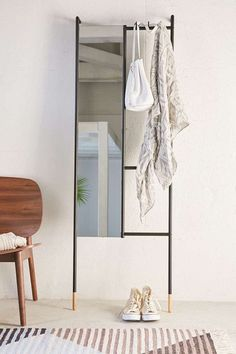Urban Outfitters Leni Leaning Mirror Ideal for an entryway or bedroom, this leaning mirror-ladder-combo serves as a catchall for your stuff as you run out the door (and arrive home!) and a mirror for a last look, of course. 27 tiny apartment finds that Small Apartment Furniture, Small Apartment Bedrooms, Small Apartments, Small Spaces, Small Bedrooms, Small Apartment Entryway, College Apartments, Studio Apartments, Dorm Rooms
