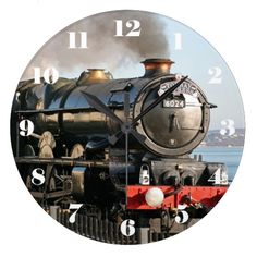 GWR King Class 6024 King Edward I - all numbers Wall Clock.  A wall clock for a train enthusiast, this features GWR King class 4-cylinder 4-6-0 No. 6024 King Edward I. King Edward I served for over thirty years on the Great Western Railway and the Western Region of British Railways, regularly hauling prestige express passenger services such as the Cornish Riviera Express. He now does regular duty as the Torbay Express, running the Dawlish Sea Wall line to Torquay and Paignton. The clock face…