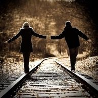 Cute engagement photo (maybe on tracks in down town Waxhaw)