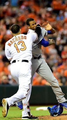 Manny Machado #13 of the Baltimore Orioles and Yordano Ventura #30 of the Kansas City Royals fight in the fifth inning during a MLB baseball game at Oriole Park at Camden Yards on June 7, 2016 in Baltimore, Maryland. Machado and Ventura were ejected from the game.