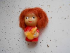 Vintage Tiny Rubber Doll Finger Puppet with red hair doll is marked Japan by Midwestgirl on Etsy https://www.etsy.com/listing/151944678/vintage-tiny-rubber-doll-finger-puppet