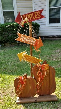 """RECYCLED WOOD PALLETS: How cute is this? The direction yard/porch sign is 48"""" tall. You chose how you want it to stand. We can make a stand or add a pointed end so you can push it into the ground or hay bale. The arrows are 16"""" x 4"""" and let everyone know where to go to get to the apples, pumpkins and corn. This item is being sold for $20. (The pumpkin duo in front is not included but can be purchased for $22.) Thanks for looking and have a blessed day.  Item # 303"""