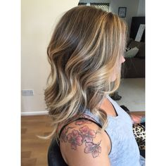 Blonde balayage, medium length ,subtle layers.