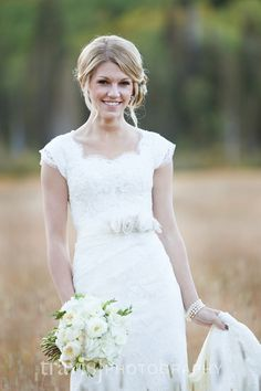 Cap sleeved modest lace wedding dress - really lovely cut of neckline/shoulder with the lace