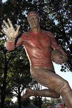"""RUTGERS """"The First Game"""" statue at Rutgers Stadium.   Prior to every home football game, the team travels down the """"Scarlet Walk"""" and touches the statue."""