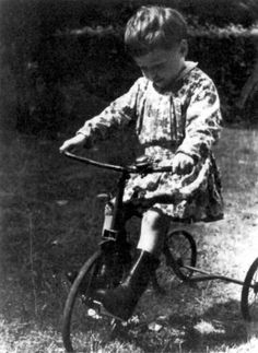 Amsterdam, Netherlands, A Jewish girl on her tricycle.  She would be gassed to death by the Nazis