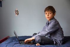 Filip Icev, 10, writes code on his laptop at his home in Kirkland, Wash., using a visual-programming language called Scratch.