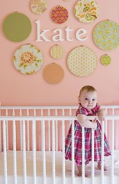 wooden letters, embroidery hoops, fabric and glue to complete this DIY nursery project. by louise