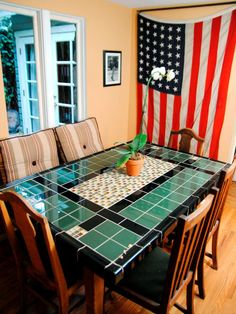 Give new life to an old table by resurfacing the top in tile.  I like the variation in tile size and color